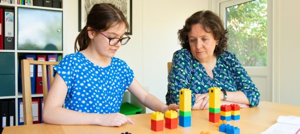 Child learning with a science tutor